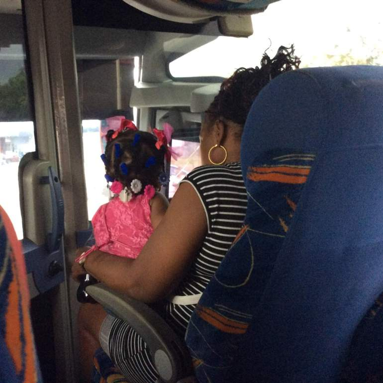 On the bus in Panama City - local child with beautifully decorated hair